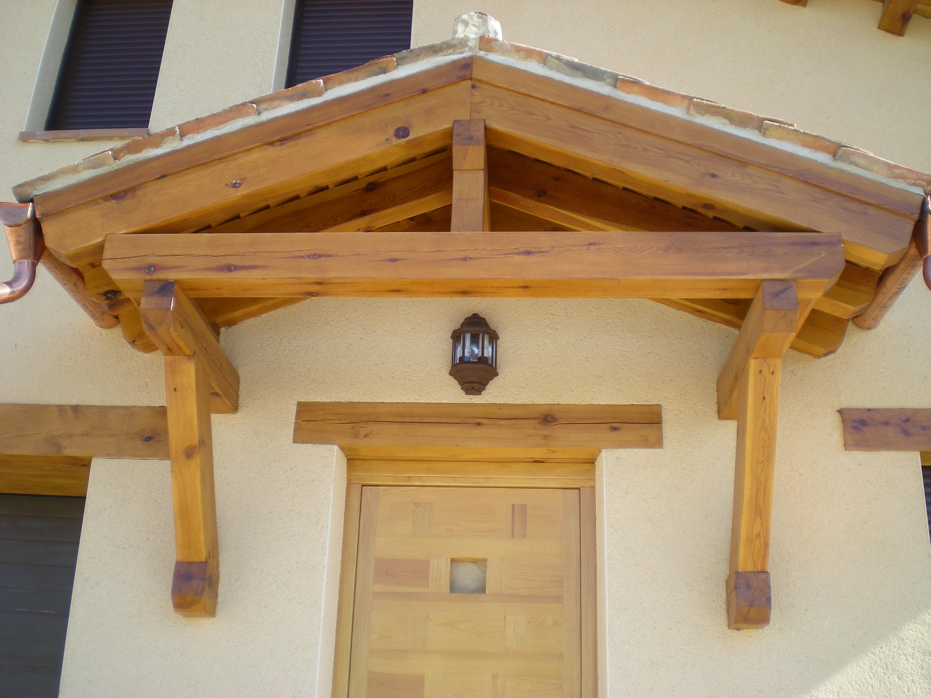 Tejadillos de madera para puertas de entrada affordable - Tejadillo para puerta ...